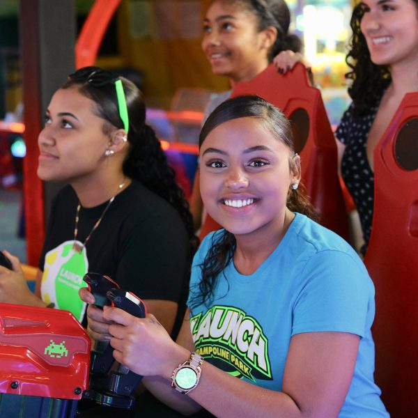 Two girls playing arcade games at Launch Trampoline Park