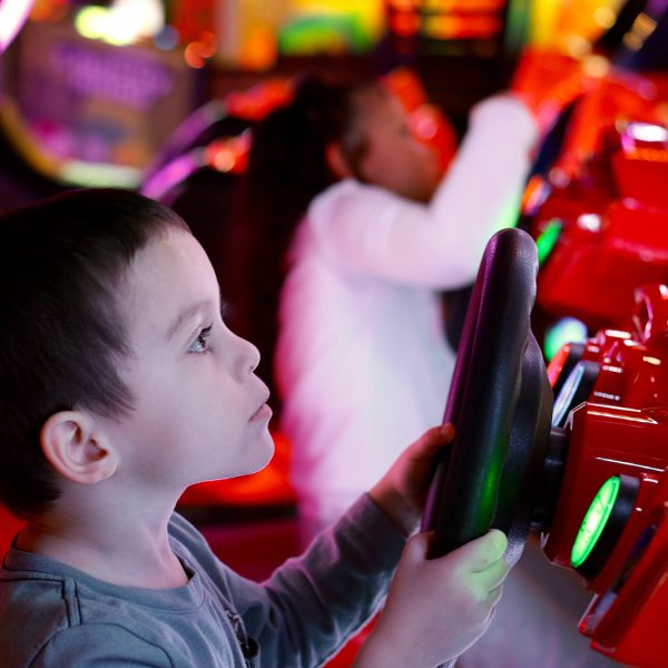 Boy having fun playing arcade game at Launch Trampoline Park