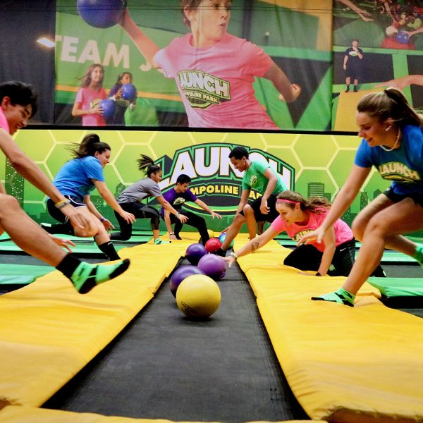 Teens playing trampoline dodgeball at Launch Trampoline Park