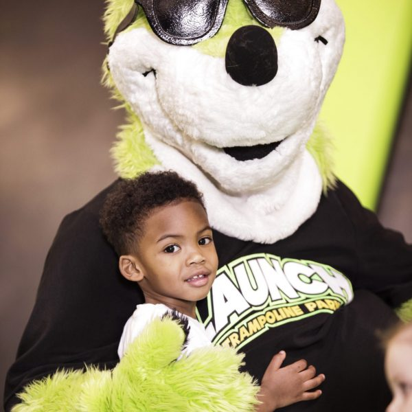Boy having fun with Joey, Launch Trampoline Park's kangaroo mascot