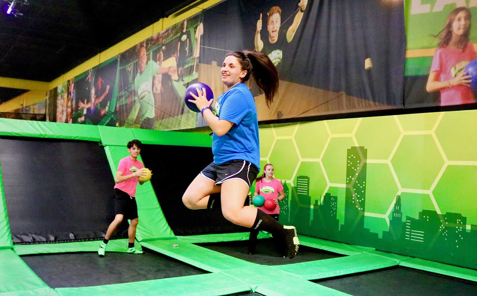 dacc07ffda Girl jumping in the air playing dodgeball at Launch Trampoline Park